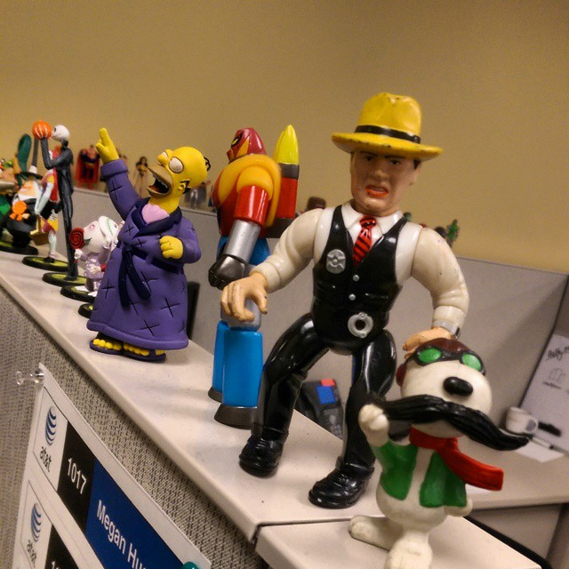 Every time I walk past this guy's cubicle at work, it makes me smile. He must have 100 little figurines on and around him!